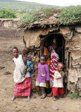 Masai children. MASAI MARA - JUNE 23: Picture of some masai children resting beside their home. The oldest children look after the youngest. June 23, 2007 in Stock Photography