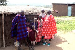 Masai family outside their house Stock Photos