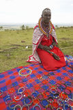 Masai female in robe with beads selling jewelry in village near Tsavo National Park, Kenya, Africa Stock Images