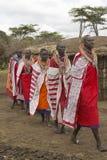 Masai females in robes singing in village near Tsavo National Park, Kenya, Africa Royalty Free Stock Photo