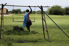 Masai girl swinging Royalty Free Stock Photography