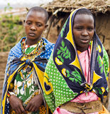 Masai girls. KENYA-2008,JULY 13. : Two young Masai girls offering for selling decorative beads in native Masai village nearby Ololaimutiek Gate to NR Masai Mara Royalty Free Stock Images