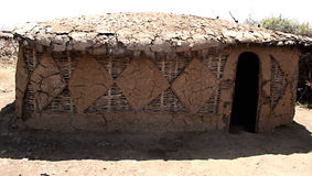 Masai house. In masai village, made by mud and brushwood royalty free stock images