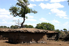 Masai house. Tipical masai house in masai village, made by mud and brushwood in Kenya royalty free stock photo