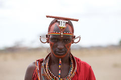 Masai man. With traditional dress and jewellery. The Masai are a Nilotic ethnic group of semi-nomadic people located in Kenya and northern Tanzania. They are Stock Photo