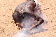 Masai man getting fire Royalty Free Stock Photo