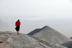 Masai man on hills covered by volcanic ashes, Great Rift Valley, Tanzania, Eastern Africa royalty free stock images