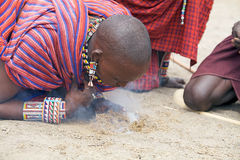 Masai man is making the fire Royalty Free Stock Photo
