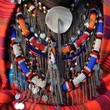 Masai Mara - Kenya / December 2017: colorful Masai accessories with beautiful details as seen in Masai man chest. royalty free stock image