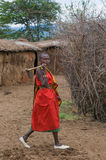 MASAI MARA, KENYA - September, 23: Young Masai woman with ax on Stock Photos