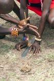 Masai mara kneeling firing Royalty Free Stock Images