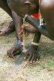 Masai mara kneeling firing Royalty Free Stock Photography