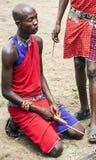 Masai mara kneeling firing Stock Images