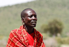 Masai mara warrior with big hole pierced in ears. MASAI MARA, KENYA-OCTOBER 19: A Masai warrior in traditional dress at a Masai Mara Village, Kenya on October 19 Stock Photography
