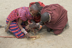 Masai men are making the fire Royalty Free Stock Photo