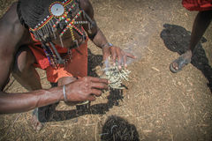 Masai men making fire  Stock Images