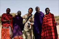 Masai with photographer. Royalty Free Stock Photography