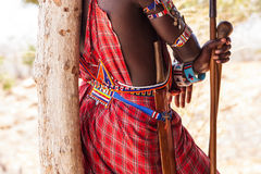 Masai traditional costume. Kenya. Detail of the traditional Masai red costume Royalty Free Stock Images