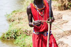 Masai traditional costume. Kenya. Detail of the traditional Masai red costume Stock Images