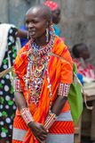 Masai tribe traditional dressed woman in Africa, Kenya. Masai tribe traditional dressed women and man. Decorated with hand made colorful jewelry village woman in royalty free stock image