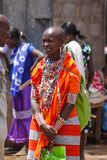 Masai tribe traditional dressed woman in Africa, Kenya. Masai tribe traditional dressed women and man. Decorated with hand made colorful jewelry village woman in stock photography