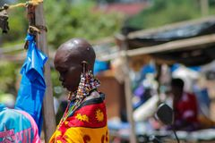 Masai tribe traditional dressed woman in African market. Masai tribe traditional dressed decorated with hand made jewelry village woman in Africa street in Kenya Stock Image