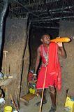 Masai Villager Drinking Blood Inside His Home Royalty Free Stock Photo