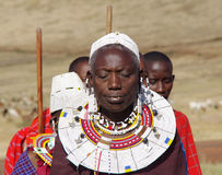 Masai Village.Tanzania. Maasai women in national dress and traditional jewelery from beads.February 2011 Stock Images
