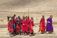 Masai Village.Tanzania. Masai men in traditional dress show performance for tourists.February 2011 Stock Photo