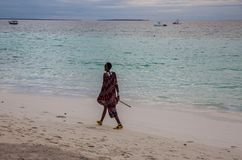 Masai walking along the shore royalty free stock photography