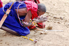 Masai warriors. AMBOSELI, KENYA ,OCT. 13: Portrait of young Masai warriors showing how they make fire in a traditional way to guests visiting their village taken Royalty Free Stock Image