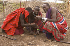 Masai warriors lighting fire Stock Photography