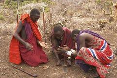 Masai warriors lighting fire Royalty Free Stock Photo