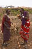 Masai warriors lighting fire royalty free stock photos