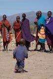 Masai warriors looking at masai kid Royalty Free Stock Photo