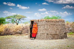 Masai With Traditional Hut. Tanzania. Stock Photos