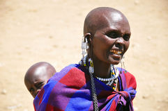 Masai woman. SERENGETI, TANZANIA - NOV 23: Unidentified Masai woman adorned with jewels on November 23, 2011 in the Serengeti, Tanzania. Masai women wear many Royalty Free Stock Photos