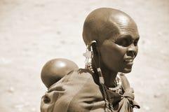 Masai woman. SERENGETI, TANZANIA - NOV 23: Unidentified Masai woman adorned with jewels on November 23, 2011 in the Serengeti, Tanzania. Masai women wear many Stock Photo
