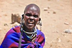 Masai woman. SERENGETI, TANZANIA - NOV 23: Unidentified Masai woman adorned with jewels on November 23, 2011 in the Serengeti, Tanzania. Masai women wear many Royalty Free Stock Photography