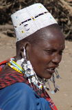 Masai woman in beaded hat and jewelry Stock Photos