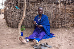 The Masai woman does her handmade souvenirs for selling in the time that tourists go to Stock Images