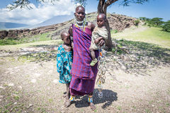 Masai woman with her kids Stock Photos