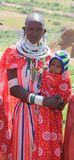 Masai woman holding her baby royalty free stock images