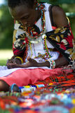 Masai woman selecting beads. Colourful beads being selected by a Masai woman in Negrende Stock Images