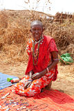 Masai woman is showing traditional jewelry stock photo