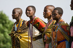 Masai women sing and dance a traditional performance. Stock Photo