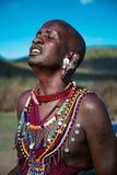 Masaiman som sjunger med passion royaltyfria foton