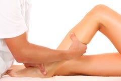 Masaje de la pierna Fotografía de archivo libre de regalías