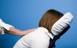 Masaje de la silla Foto de archivo libre de regalías