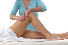 Masaje de las rodillas Foto de archivo libre de regalías